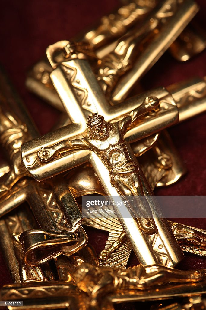 Gold crosses for sale are displayed February 20, 2009 in Los Angeles, California. Gold futures finished the day above $1,000 an ounce for the first time in nearly a year, with investors eyeing the precious metal as a safe haven from declining stock markets and plummeting real estate values. April delivery of gold finished the day at $1,002.20, up $25.70, or 2.6 percent.