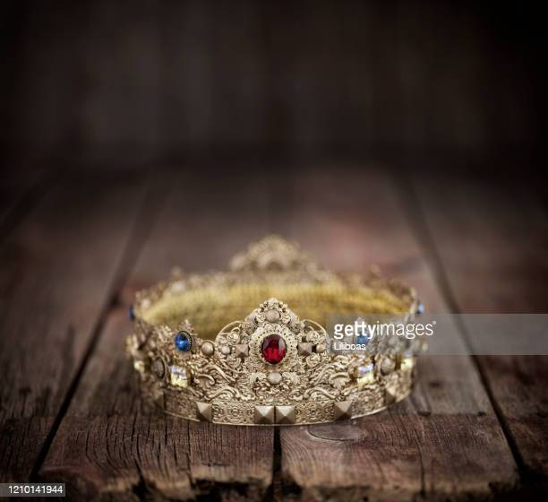 gold crown on an old wood background - resurrection religion stock pictures, royalty-free photos & images