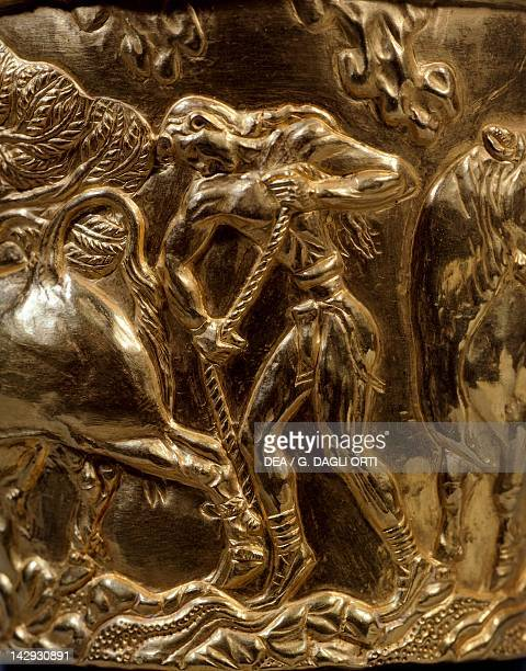 Gold cup with relief decoration from the Tholos Tomb of Vaphio of Sparta Detail bull taming Goldsmith art Mycenaean Civilization 16th15th Century BC...