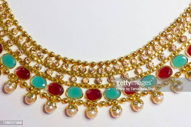 gold designer necklace laying on white background - necklace stock pictures, royalty-free photos & images