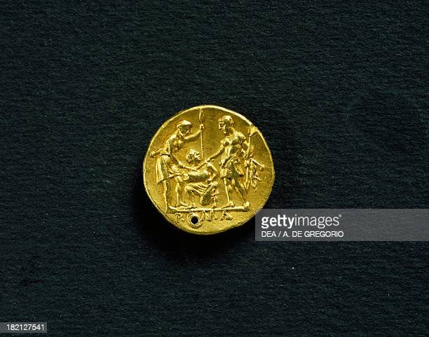 Gold didramma with two warriors sticking swords into a pig 289 BC verso Roman coins 3rd century BC