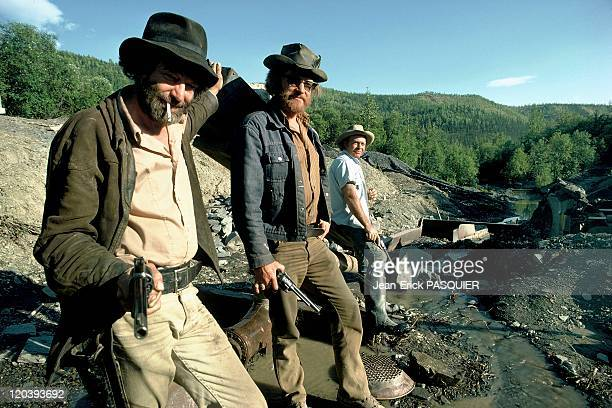 Gold digger in Alaska, United States - West of Fairbanks, Tom Walker, Keith Jones and Robert Roberts are gold diggers. The three of them each carry a...
