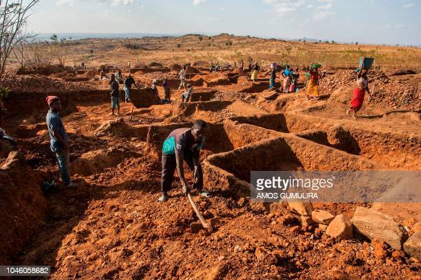 Gold digger Labison Phinde works at a plot he bought in Lumwira village in central Malawi's Lilongwe district where a gold rush is taking place on...