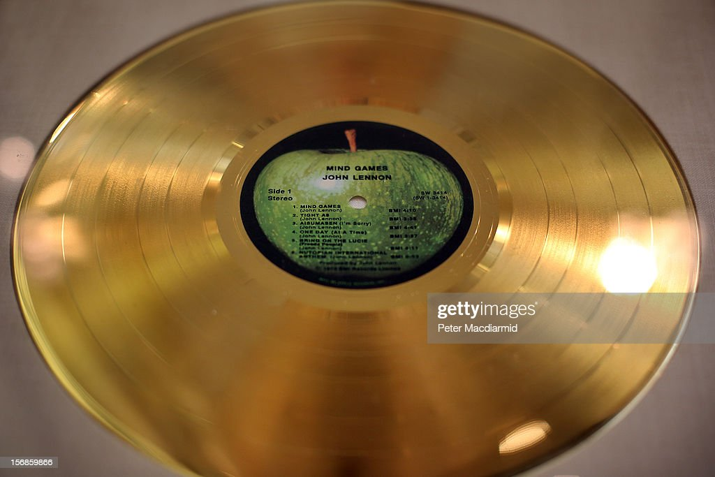 A gold disc of John Lennon's Mind Games album is displayed at Christie's on November 23, 2012 in London, England. The disc forms part of Christie's Pop Culture sale on November 29 in London.