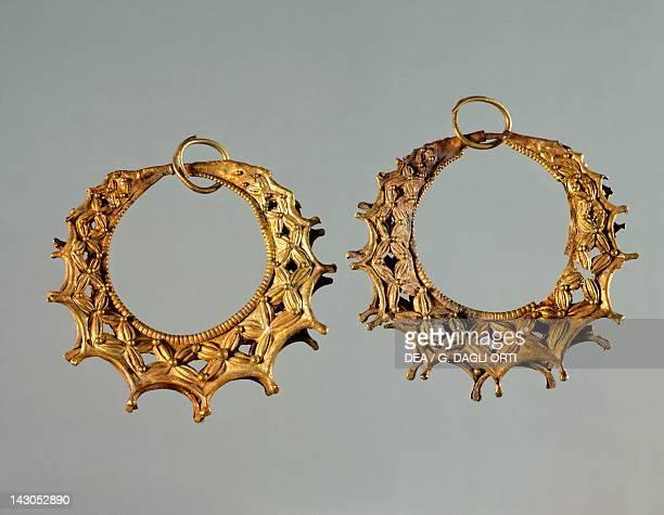 Gold earrings from Tomb III of the Circle A of Mycenae Goldsmith art Mycenaean Civilization 16th Century BC Athens Ethnikó Arheologikó Moussío