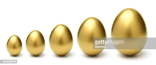 gold eggs grow from small to large on white background - animal egg stock pictures, royalty-free photos & images