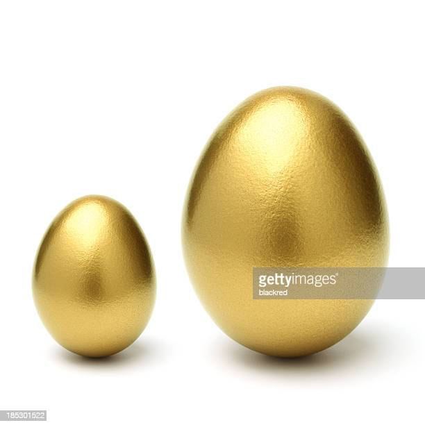 Gold Eggs Grow From Small to Large on White Background