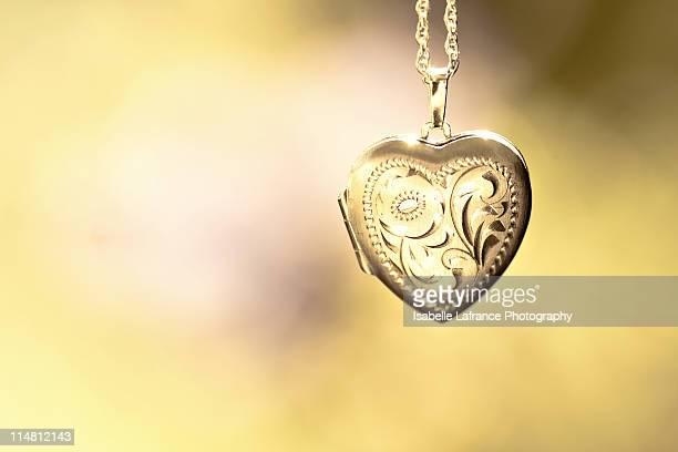Gold engraved heart locket