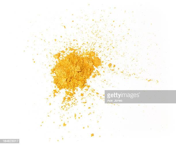 Gold eyeshadow powder isolated on white background