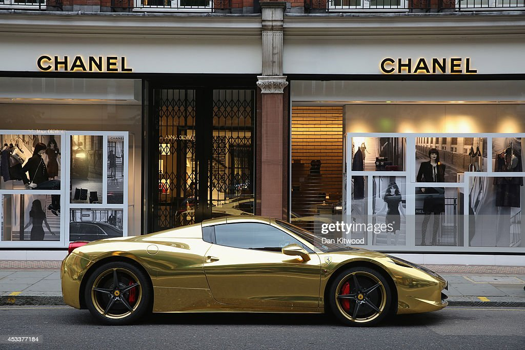 A Gold Ferrari sits outside Chanel on Sloane Street on August 8, 2014 in London, England. Tourists and car enthusiasts have been flocking to the wealthy London district to see some of the world's most expensive and extravagant super cars. Many of the rich owners from Saudi Arabia and Kuwait come to London to escape the summer heat at home and to show off their cars before moving on to other European cities such as Paris and Cannes.