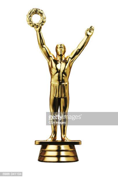 gold figurine holding wreath - award stock pictures, royalty-free photos & images