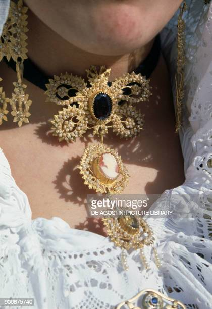 Gold filigree necklace embellished by motherofpearl stones cameo pendants detail from the traditional female costume of Sinnai Sardinia Italy