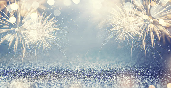 Gold Fireworks and bokeh in New Year eve and space for text. Blue Abstract background holiday. 878876720