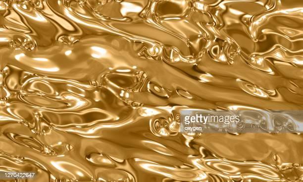 gold fluid melting waves flowing liquid motion abstract background - goldfarbig stock-fotos und bilder