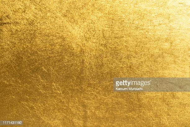gold foil background - gold coloured stock pictures, royalty-free photos & images