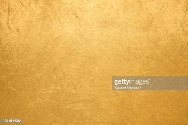 gold foil texture background - gold colored stock pictures, royalty-free photos & images