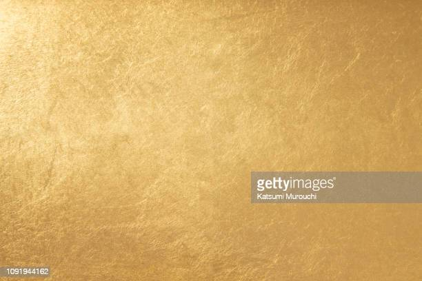 gold foil texture background - gold coloured stock pictures, royalty-free photos & images