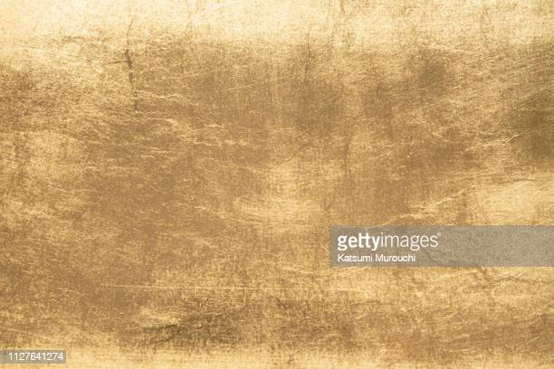 gold foil texture background - brass stock pictures, royalty-free photos & images