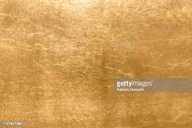gold foil texture background - gold colored stock photos and pictures