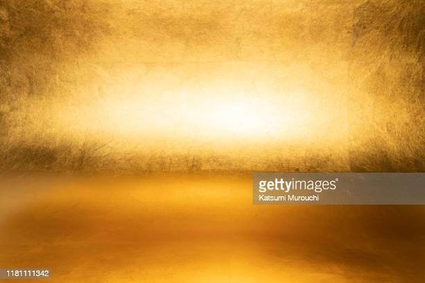 gold foil wallpaper texture background - gold coloured stock pictures, royalty-free photos & images