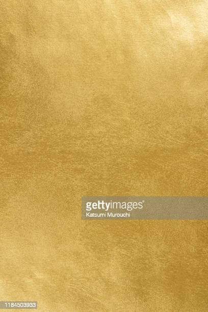 gold foil wallpaper texture background - gold colored stock pictures, royalty-free photos & images
