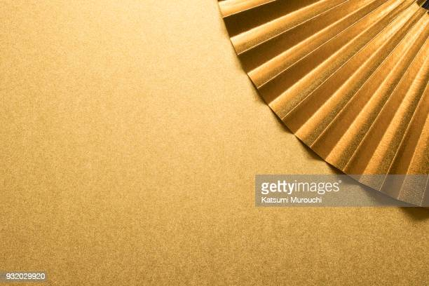 gold folding fan and copy space - japanese culture stock pictures, royalty-free photos & images