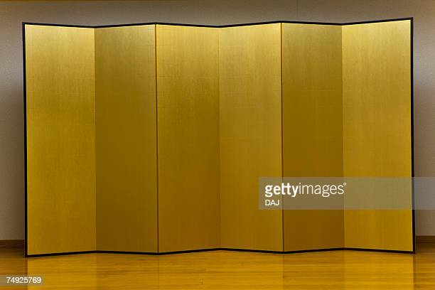 Gold Folding Screen Standing at a Stage