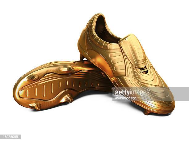 gold football boots - gold shoe stock photos and pictures