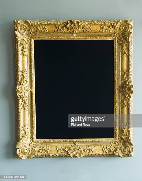 Gold frame hanging on wall