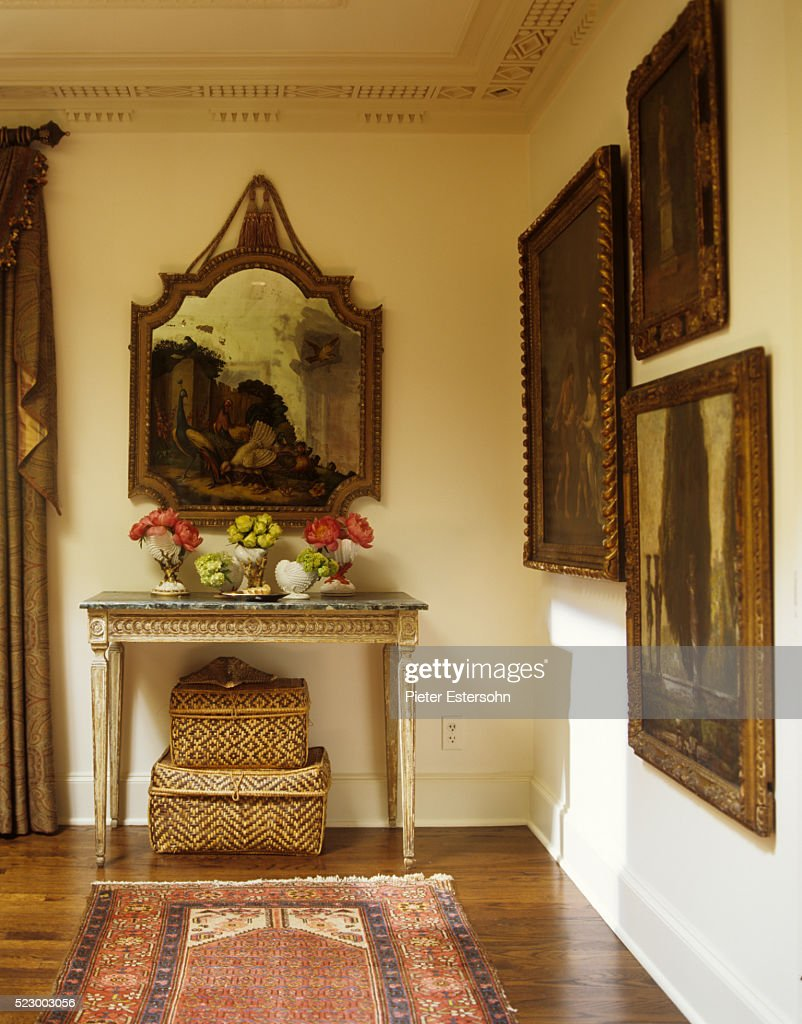 Gold Framed Paintings And Antique Table In Corner Stock Photo ...