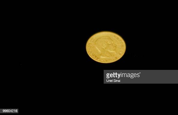 A gold French coin from 1856 bearing the image of Emperor