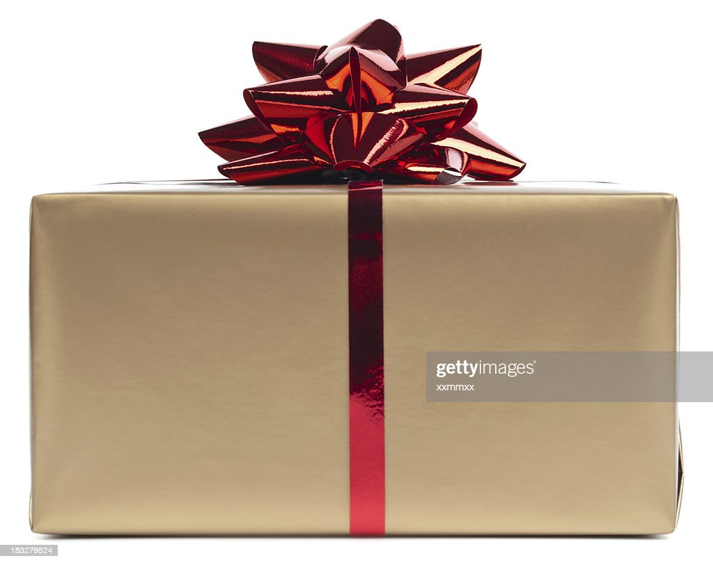 Gold gift box rapped in red ribbon : Stock Photo