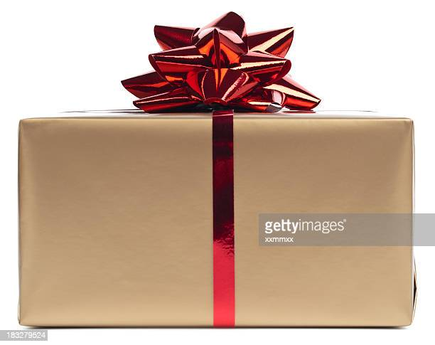 Gold gift box rapped in red ribbon