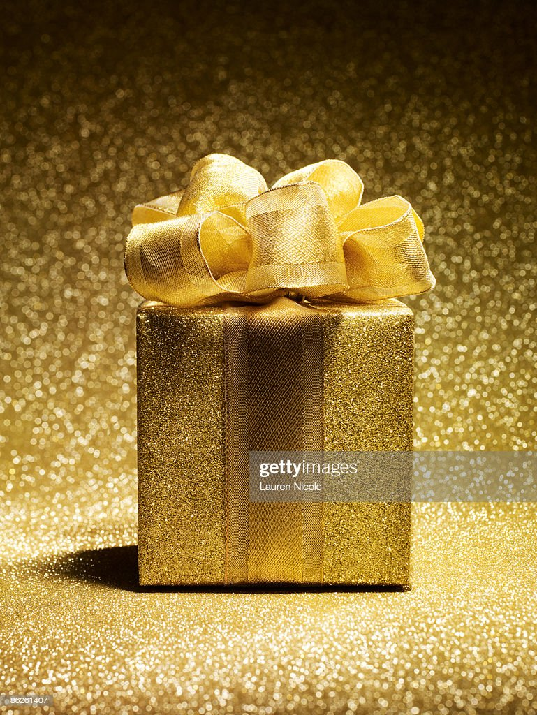 Gold gift on gold background getty images gold gift on gold background negle Images