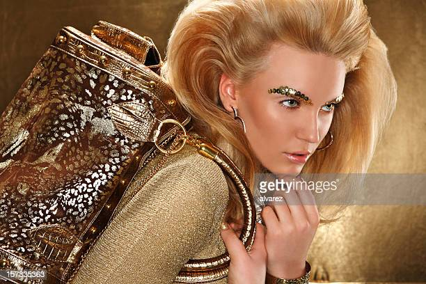 gold glamour portrait - gold purse stock pictures, royalty-free photos & images