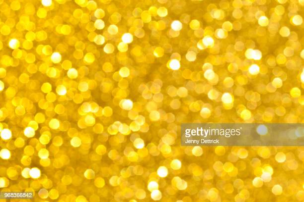 gold glitter background - shiny stock pictures, royalty-free photos & images