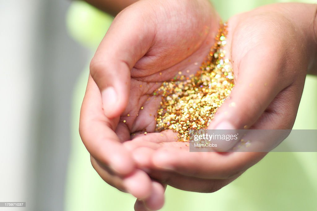 Gold Glitter In Girls Hands Stock Photo | Getty Images