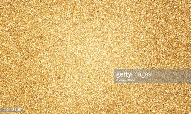 gold glitter - glitter stock pictures, royalty-free photos & images