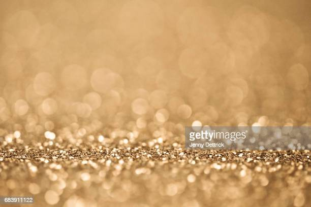 gold glitter - gold background stock photos and pictures
