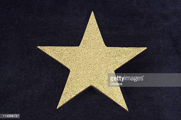 Gold Glitter Star On Dark Blue Velvet Bacground
