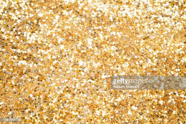 gold glitter texture background - glitter stock pictures, royalty-free photos & images