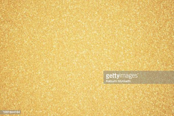 gold glitter texture background - gold colored stock pictures, royalty-free photos & images