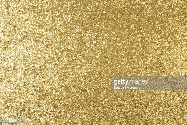 gold glitter texture background - glitter stockfoto's en -beelden
