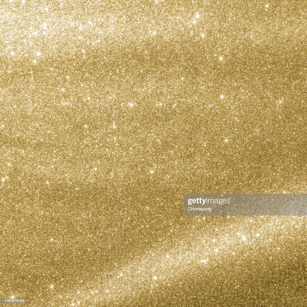 Gold glitter texture sparkling shiny wrapping paper background for Christmas holiday seasonal wallpaper  decoration, greeting and wedding invitation card design element : Stock Photo