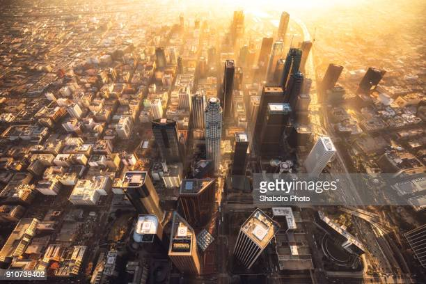 gold glow downtown - aerial view stock-fotos und bilder