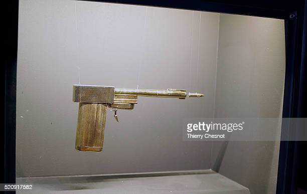 A gold gun from the James Bond film 'The Man with the Golden Gun' is displayed as part of an exhibition dedicated to James Bond 007 'The Designing...