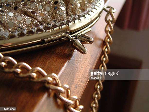 gold handbag - gold purse stock pictures, royalty-free photos & images