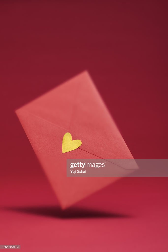 gold heart seal red envelope   in the air : Stock Photo