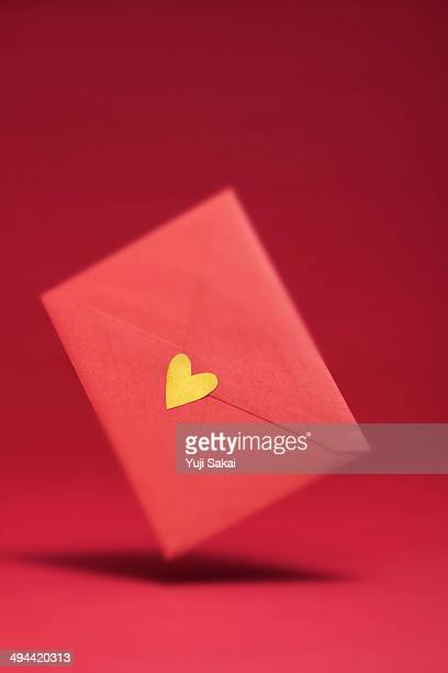 gold heart seal red envelope   in the air