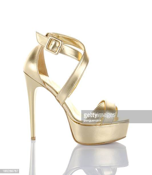 gold high heel shoe